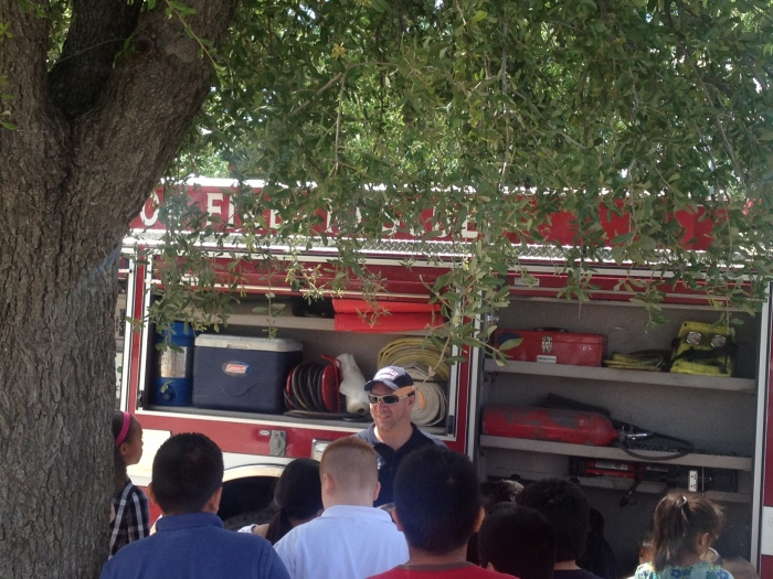Firefighter explaining the equipment