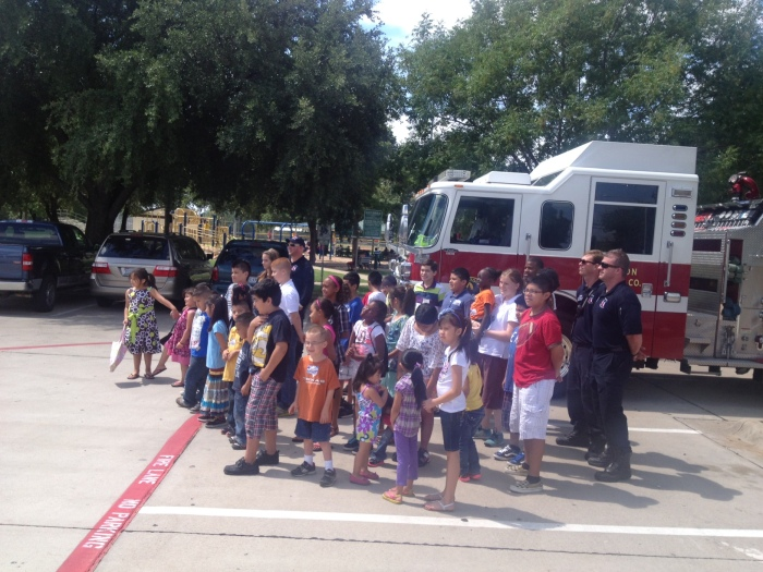 Kids and Firefighters photo op.